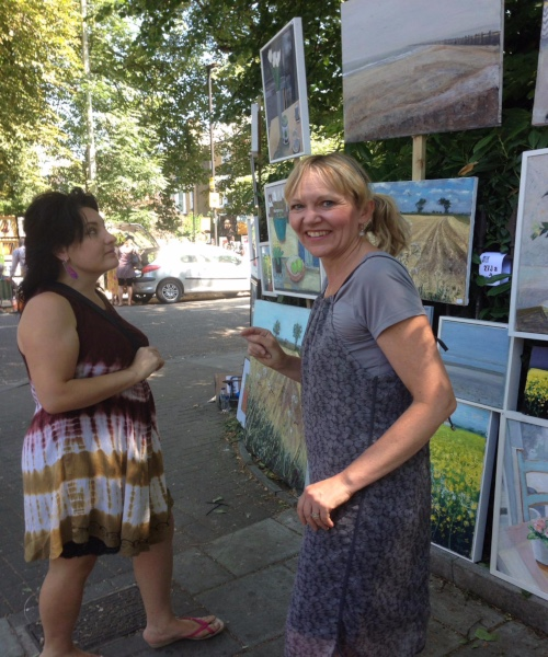 Jo sharpe at art fair selling her oil paintings and prints