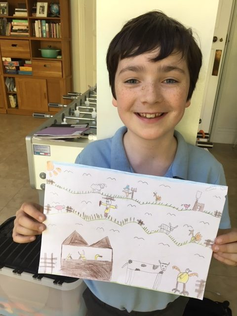 boy holding picture he drew