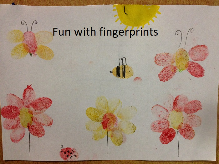 A children's picture created using fingerprints at CATS Club