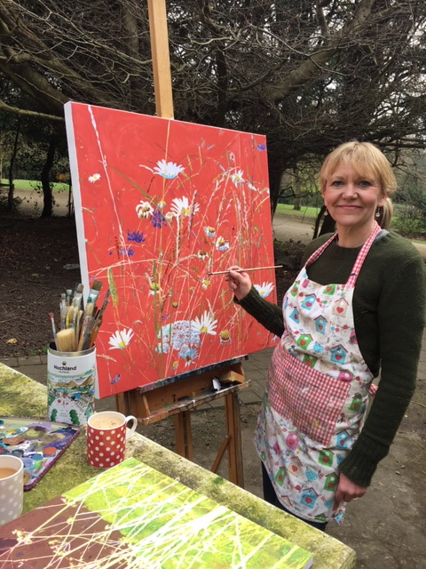 jo sharpe in the outdoors painting on canvas.