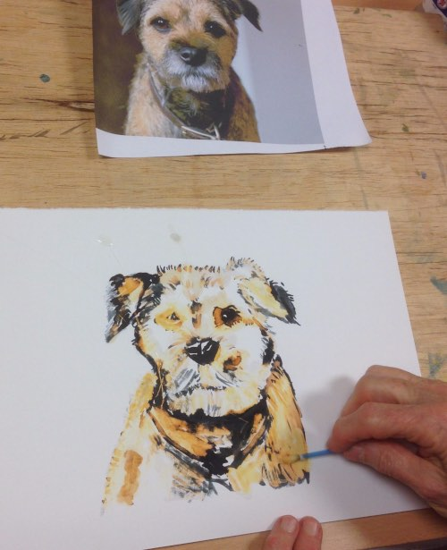 person drawing a dog from a photo of a dog