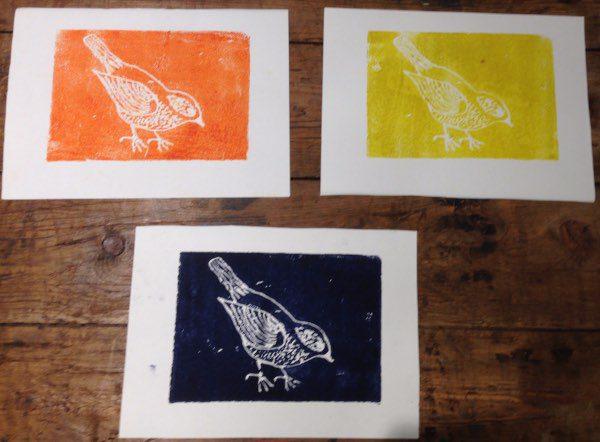 three birth prints on a table