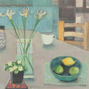 A contemporary still life with irises, a pot-plant and lemon and limes