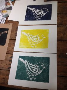 A lino cut print of a bird