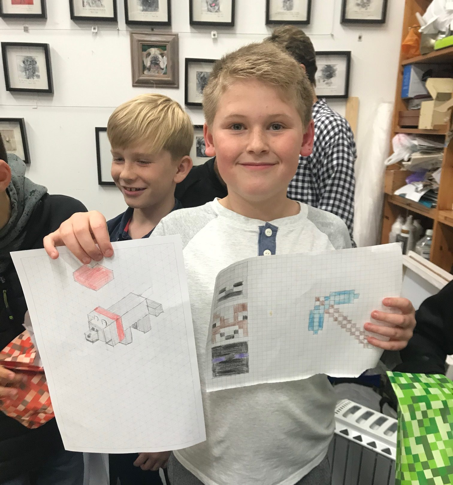 A boy showing his Minecraft drawings