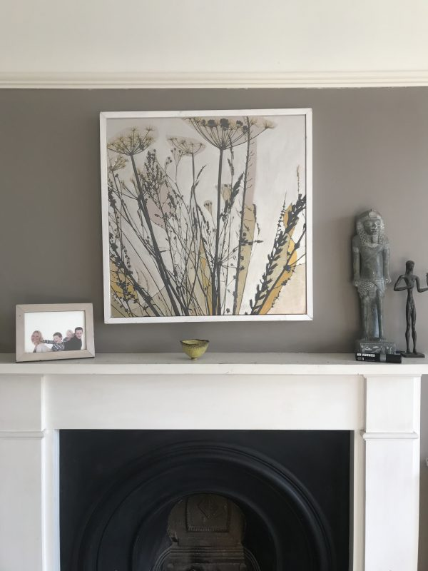Contemporary botanical seed-heads painting shown in daylight