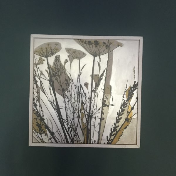 Contemporary botanical seed-heads painting shown in artificial lighting