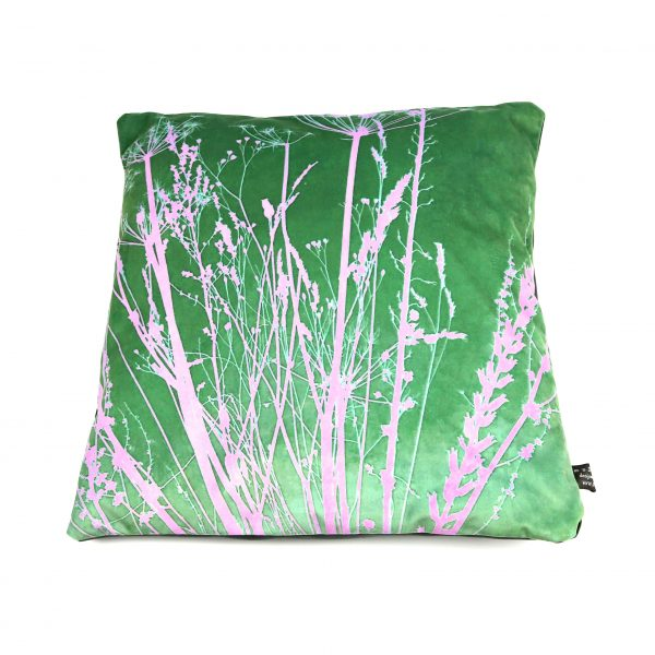A pink and green botanical cushion of some gathered seedheads